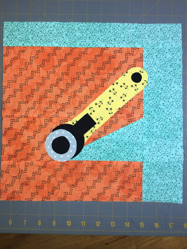 Photo and Link to Block 12: Rotary Cutter